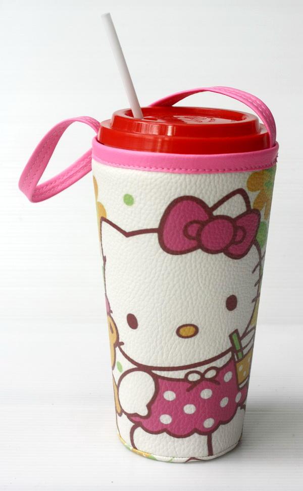แก้วเก็บความเย็น สะดวกสบายด้วยหูหิ้ว ลาย Hello Kitty ดอกทานตะวัน บนพื้นขาว เก็บความเย็นได้กว่า 5 ชั่วโมง