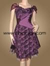ชุดราตรีผ้าไหมสีม่วง แบบมีแขน ปักริบบิ้นไหมเป็นกุหลาบปักเลื่อมและลูกปัดทั้งตัว แต่งผ้าซ้อนทับประดับลูกปัดสวยหรู