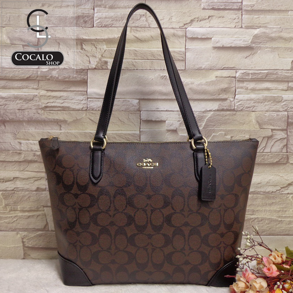 13ad858a63 COACH F29208 ZIP TOP TOTE IN SIGNATURE CANVAS. color   imitation gold BROWN  BLACK. Details   - Signature coated canvas with smooth leather details
